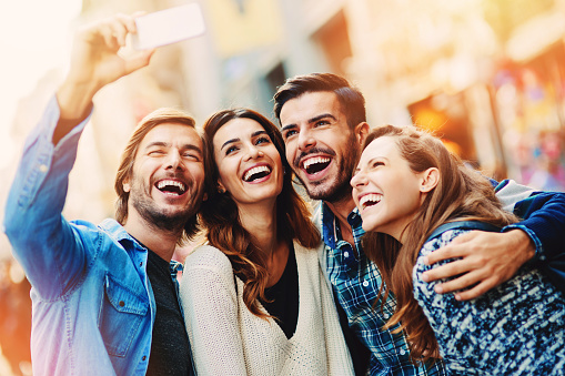smiling people taking selfie